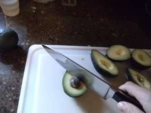 removing the pit from an avocado
