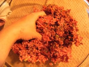 mixing seasonings into ground beef for butter burgers
