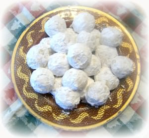 "Pfeffernusse-Crunchy-Spiced-Snowball-Cookies - A traditional European snowball cookie that is crunchy and robustly spiced. Despite the literal ""pepper nuts"" translation of the name, these cookies are nut free! 