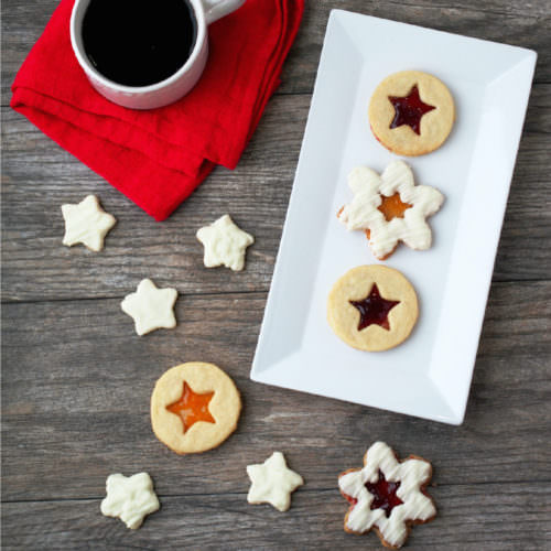 Shortbread-Linzer-Cookies are rich buttery shortbread cookies with a thin layer of preserves sandwiched between them to look like linzer cookies. They're as beautiful as they are delicious!