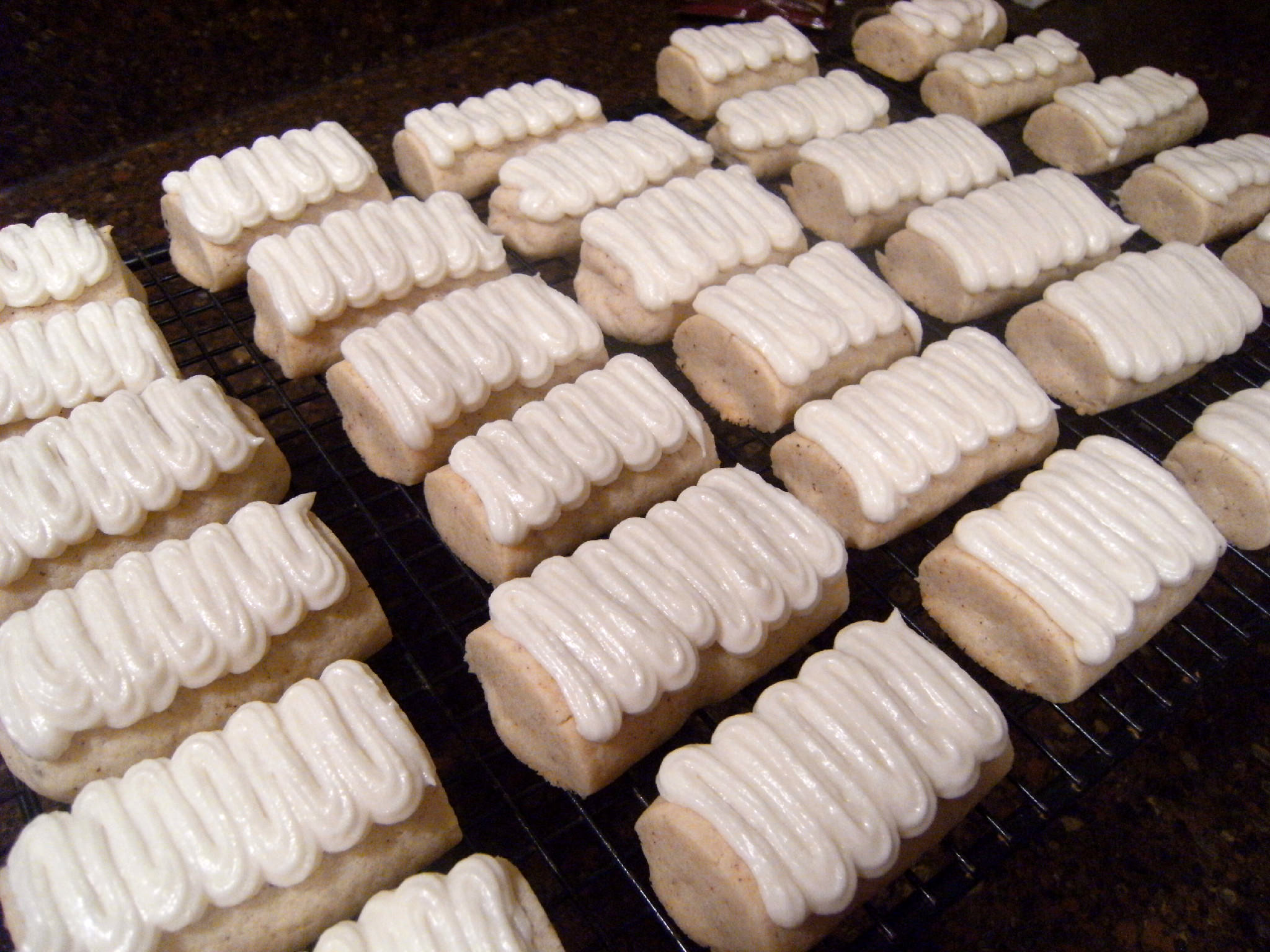 Egg-Nog-Logs are soft butter cookies infused with the flavors of egg nog, then topped with a rum flavored buttercream frosting. Alcohol free! - Get the holiday cookie recipe on www.ComfortablyDomestic.com