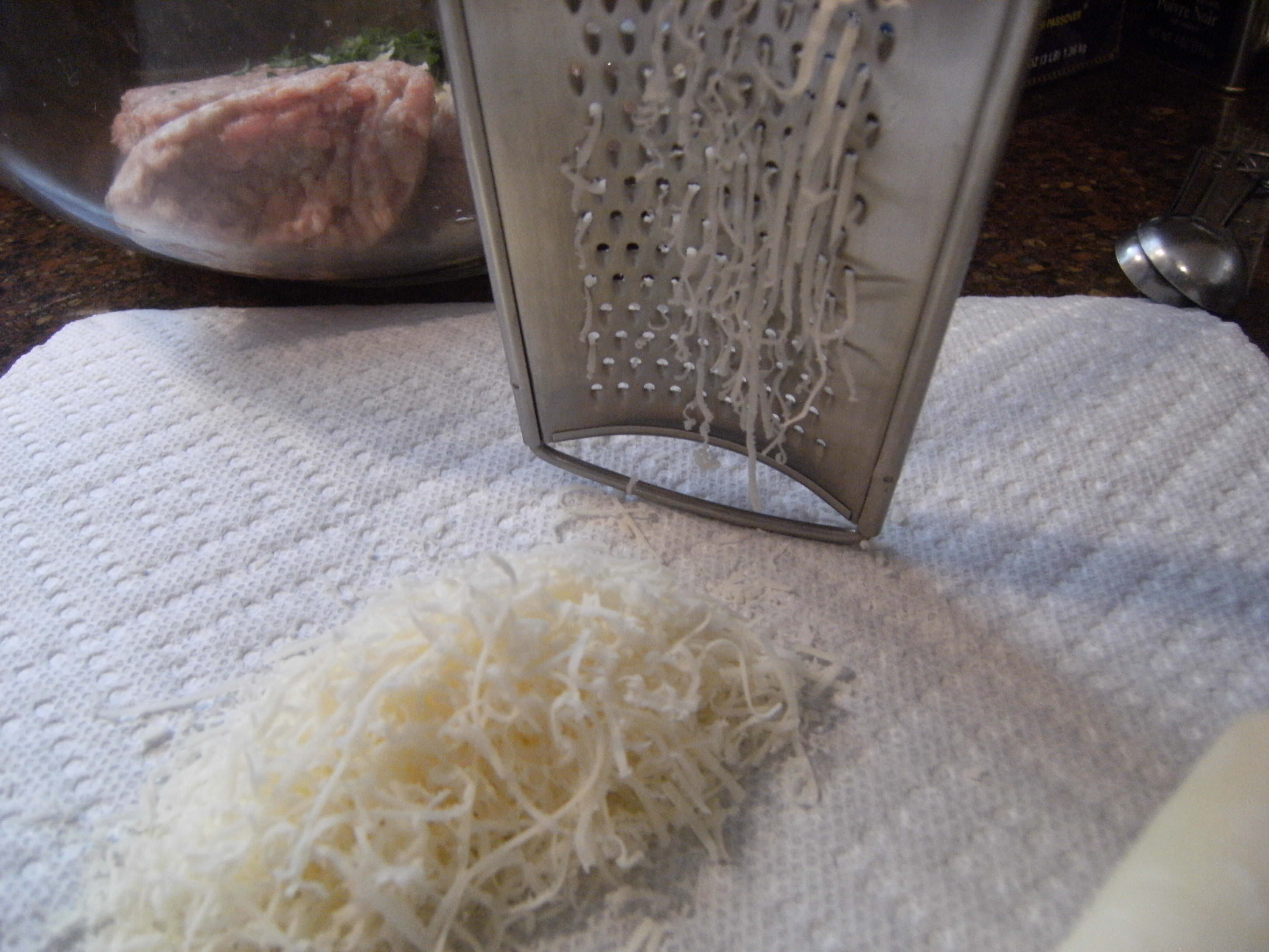 making Turkey Meatball Soup - grating cheese