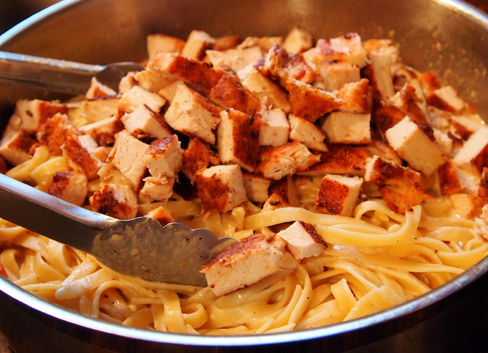 Cajun-Chicken-Fettuccine-Alfredo is a perfect meal for date night. The spicy chicken and rich cream sauce makes eating a restaurant quality meal a reality.