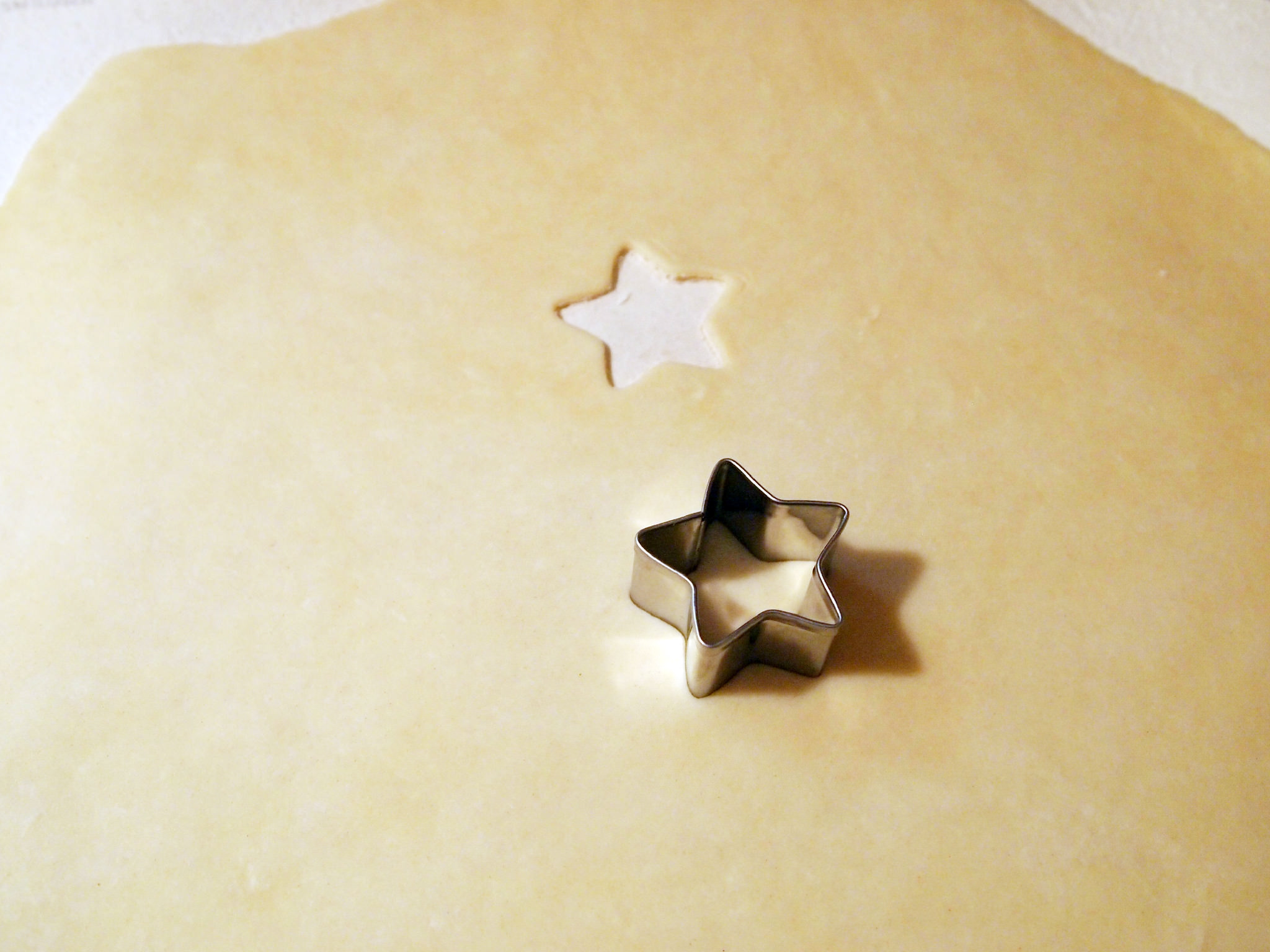 cutting stars out of pastry crust for a chicken pot pie