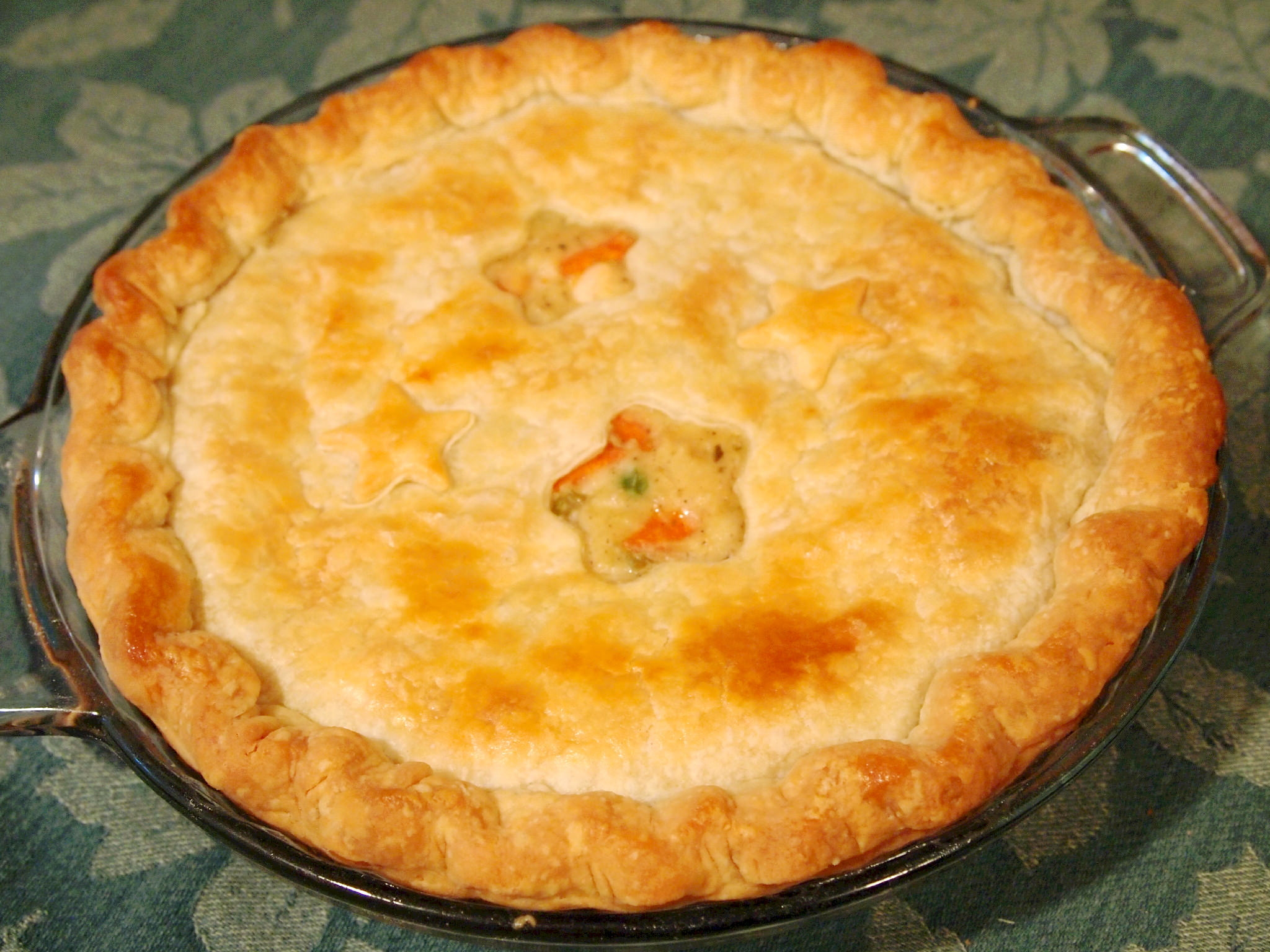 Chicken pot pie. Nothing says 'comfort food' better than tender chicken and vegetables in a rich gravy, covered with a flaky, buttery pastry crust. | Recipe on ComfortablyDomestic.com