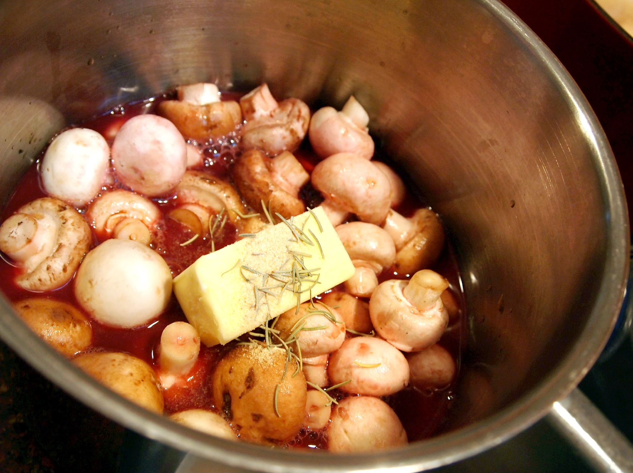 making Merlot simmered mushrooms