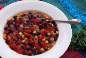 This spicy black bean soup recipe is quick and easy to make, so it's the perfect weeknight meal. Hearty and delicious, too! | ComfortablyDomestic.com