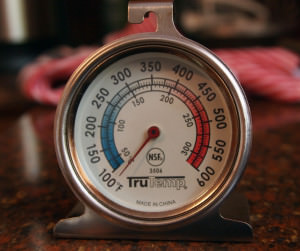 Heat and temperature in an oven are best gauged with an oven thermometer