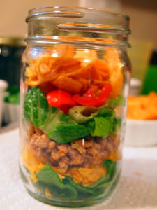 A lightened up version of walking tacos, these are made with ground turkey instead of ground beef. Served in mason jars for extra portability and fun! | ComfortablyDomestic.com