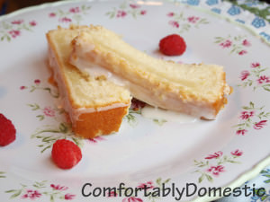 Iced lemon loaf is the perfect treat with a cup of coffee. Now there's no need to get it at the local coffee shop, because you can make it at home for a fraction of the cost!   ComfortablyDomestic.com