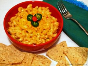 Queso macaroni and cheese is tender macaroni, drenched in a creamy Wisconsin cheese sauce, peppered with all the flavors of a queso dip.