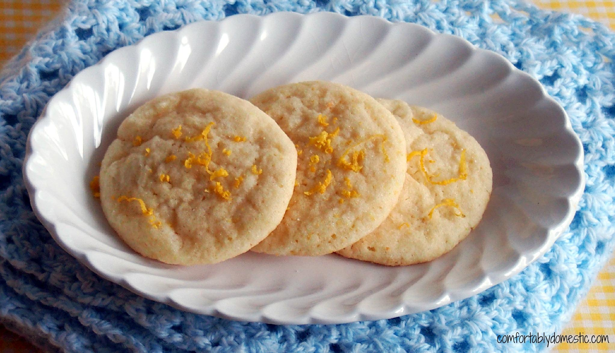 Lemon Doodles are the perfect balance between a chewy, light lemon cookie and soft lemon cake. Tangy and sweet, with a crunchy lemon sugar topping, these cookies are the ultimate treat! | ComfortablyDomestic.com