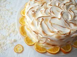 The balance of flavors and textures between moist cake, creamy lemon curd, and toasted Swiss meringue makes this Coconut Meyer Lemon Cake recipe a winner! | ComfortablyDomestic.com