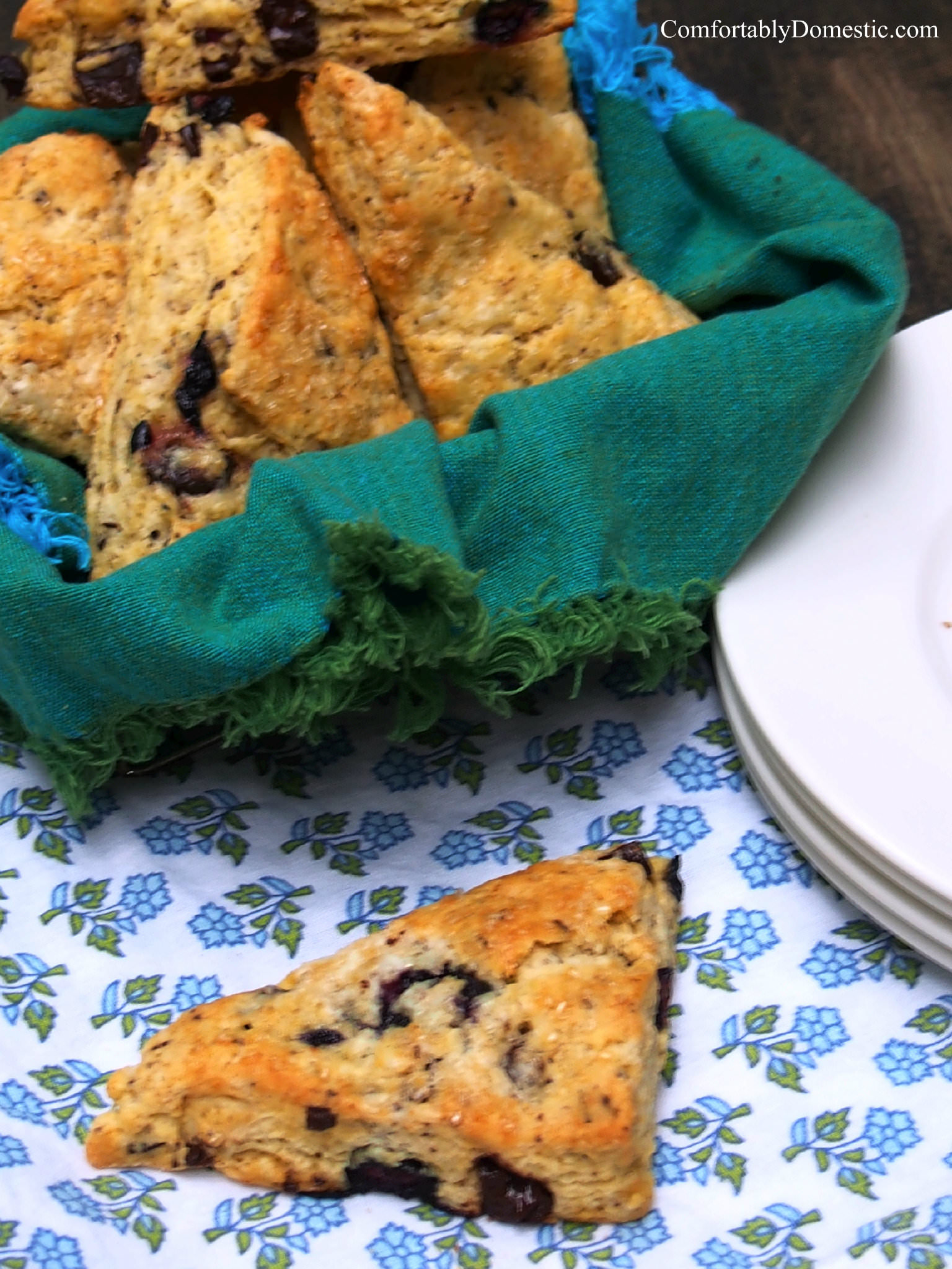Blueberry scones with dark chocolate are fluffy, buttery breakfast scones, bursting with blueberries and rich chunks of dark chocolate. | ComfortablyDomestic.com