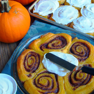 Pumpkin cinnamon rolls usher in the cool comfort of autumn any time of the year. Piping hot, and just dripping with cream cheese icing.