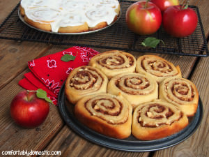 Apple cinnamon rolls are the perfect weekend brunch treat! Warm, gooey cinnamon rolls made with crisp, tart apples in the filling. | ComfortablyDomestic.com