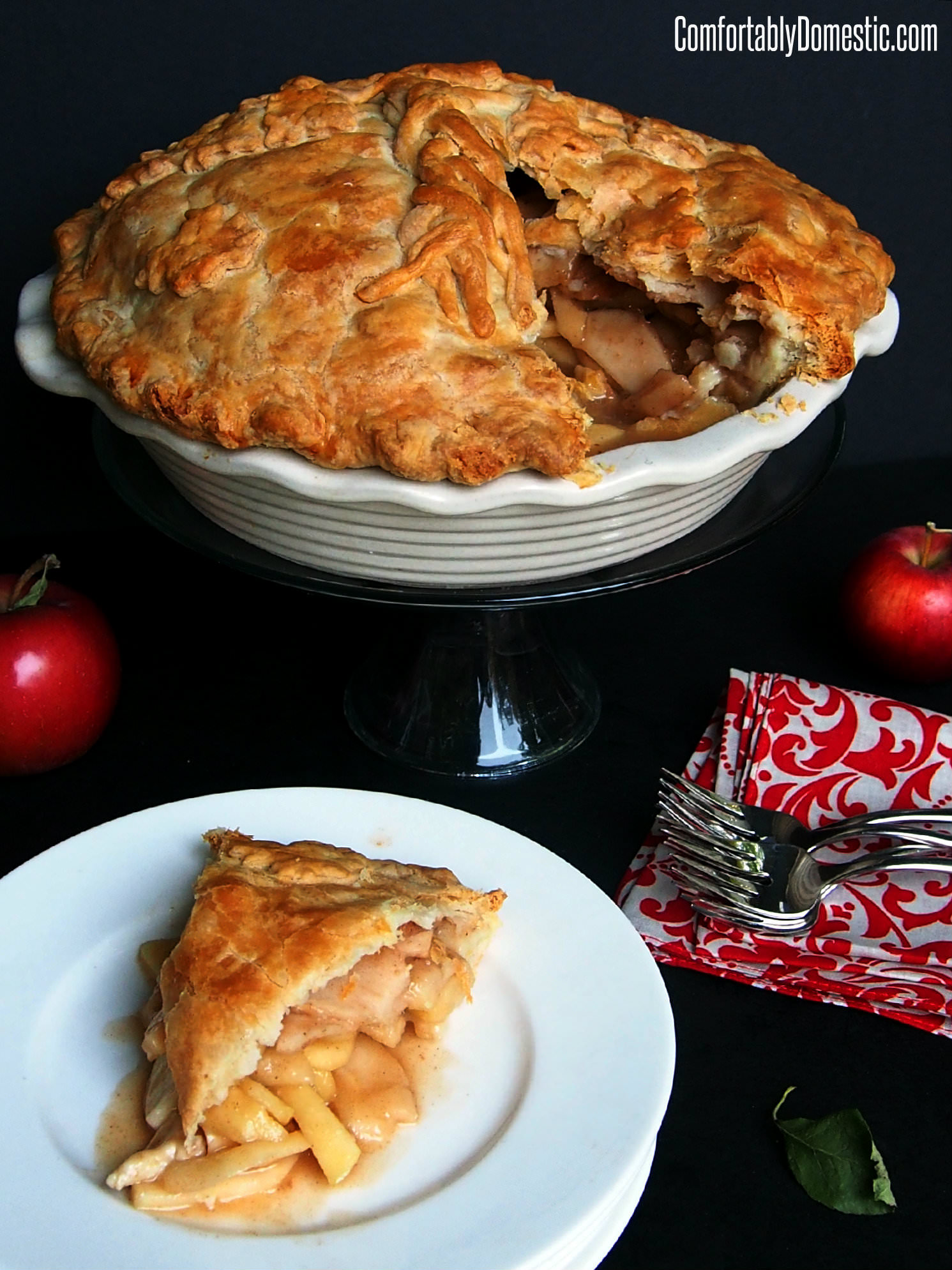 Mile high apple pie is a deep dish take on an American Classic Apple Pie, stuffed with a variety of tart apples in a caramel-like filling.| ComfortablyDomestic.com