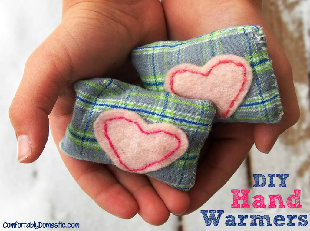 Two DIY microwavable hand warmers held in the palm of kid hands.