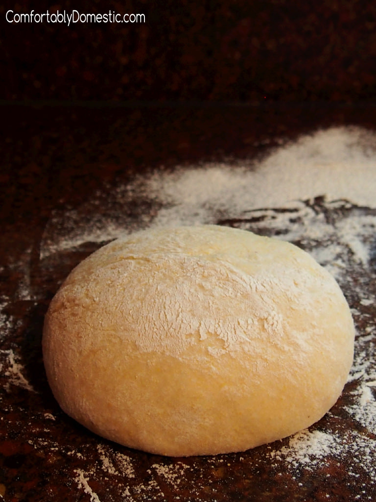 30 Minute Cornmeal Pizza Dough - Cornmeal pizza dough makes homemade pizza crust that's ready for toppings in 30 minutes, helping you create perfect pizzeria-style pizzas at home!    ComfortablyDomestic.com