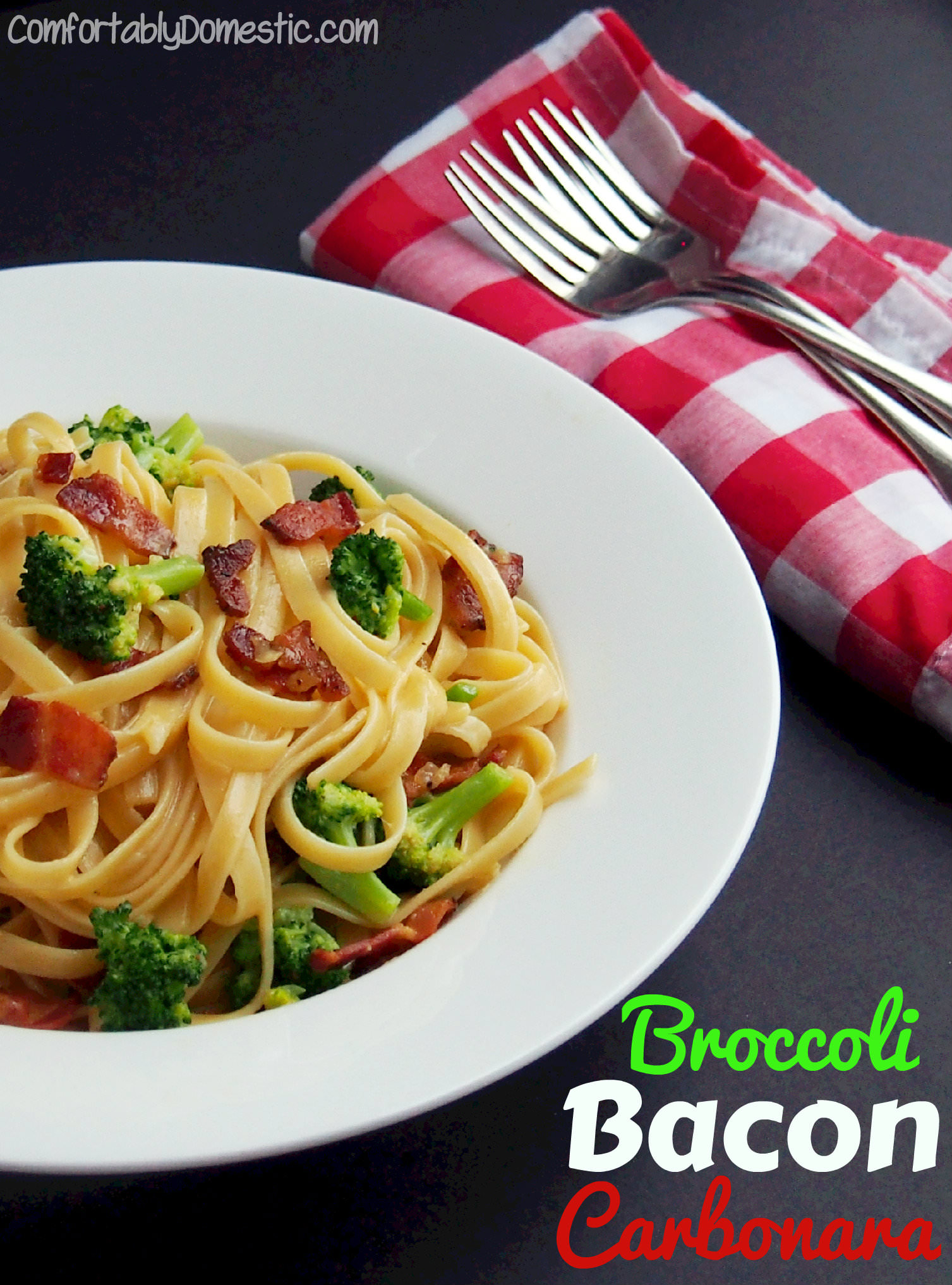 Broccoli bacon pasta carbonara is an inexpensive yet impressive meal, made with fresh broccoli, thick-cut pepper bacon, eggs, and plenty of cheese. | ComfortablyDomestic.com