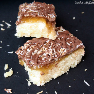 Samoa Bars are inspired by the popular Girl Scout Cookie. Crisp, buttery shortbread with salted coconut caramel, dark chocolate and toasted coconut.
