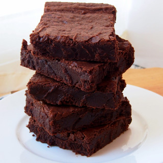 One bowl fudge brownies are possible! Warm, gooey, chocolate fudge brownies made from scratch, in the same time it takes to make them from a boxed mix! | ComfortablyDomestic.com