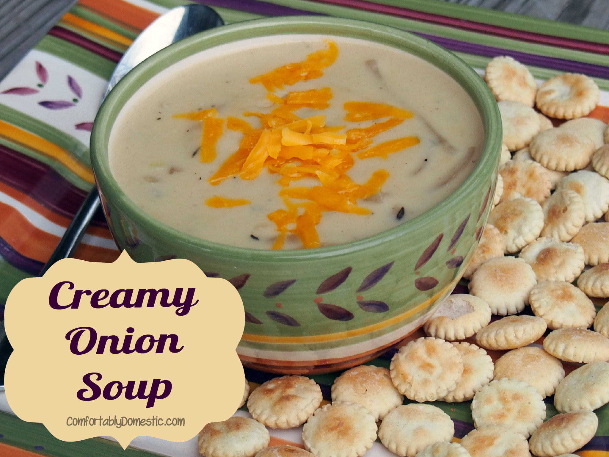 Creamy onion soup has loads of tender sweet onions, swimming in a flavorful, blended cheese base. This soup is a soothing meal or side dish. | ComfortablyDomestic.com