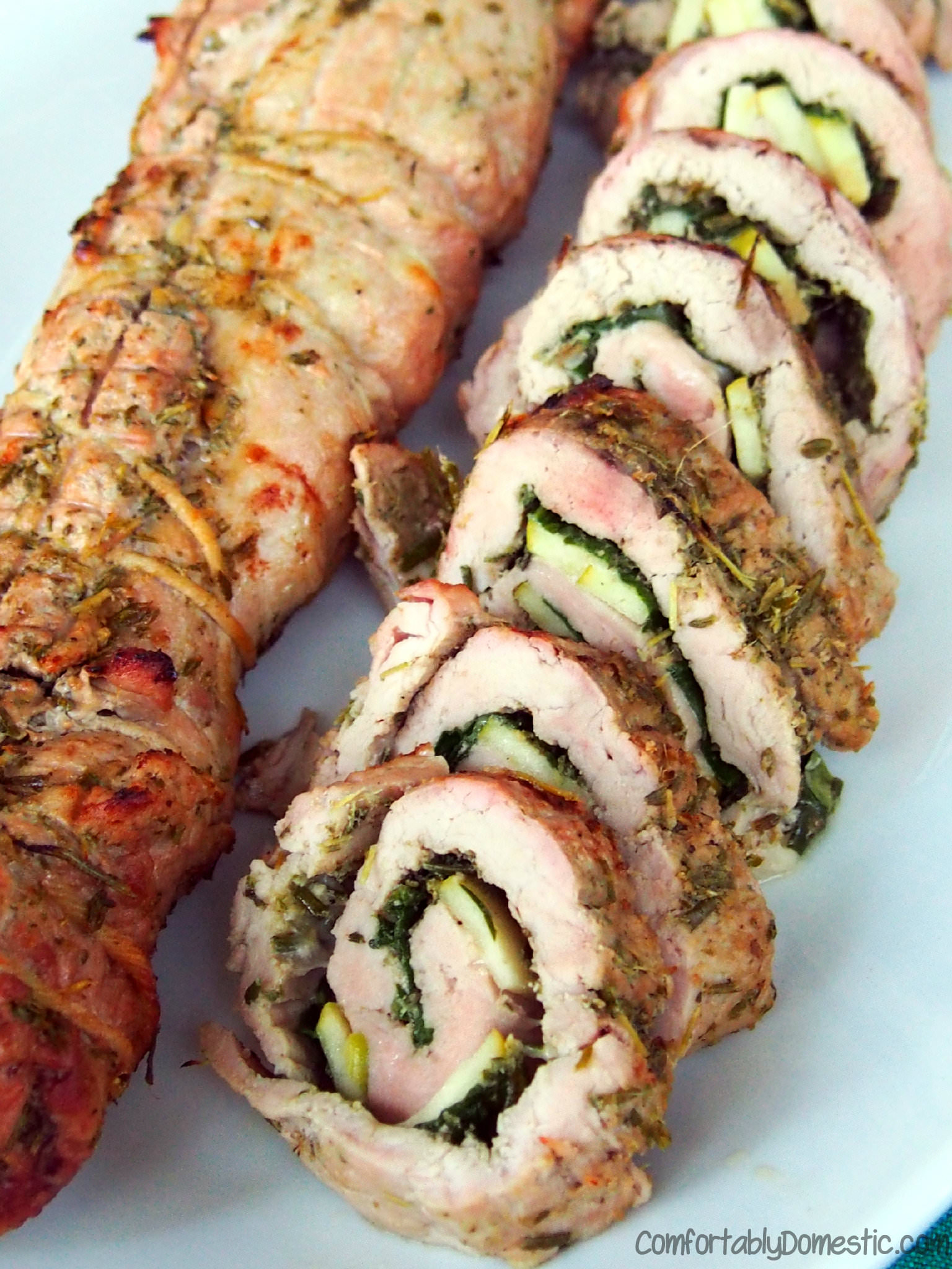 Rosemary Pesto Rolled Pork Tenderloin with Spinach, Apple, and Gouda | ComfortablyDomestic.com