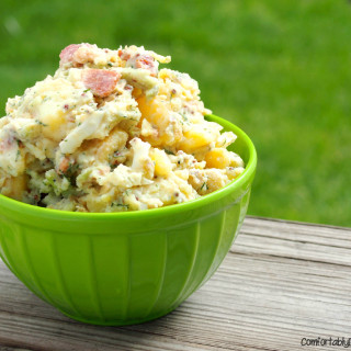 Creamy yellow potatoes are the base for dill potato salad, a lightened up version of classic potato salad, made with bacon, eggs, and plenty of fresh dill. | ComfortablyDomestic.com