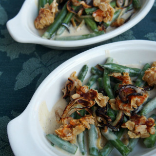 This green bean casserole recipe has NO condensed soup, and is made entirely from scratch! Covered with crisp onions and a savory cheese streusel topping. | ComfortablyDomestic.com