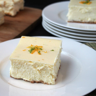 Triple Citrus Cheesecake - Classic New York style cheesecake infused with the tangy flavors of lemon, lime, and orange is made easy to share with a crowd. | ComfortablyDomestic.com
