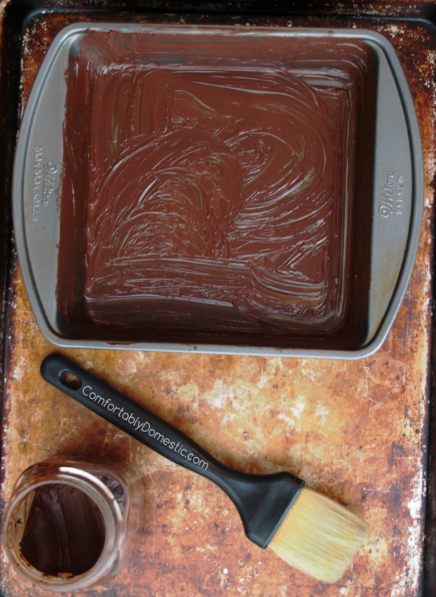 Chocolate Baking Lube is a DIY baking pan release - It inexpensively prepares baking pans to release chocolate baked goods beautifully, keeping them looking every bit chocolate in appearance, with no white residue! | ComfortablyDomestic.com