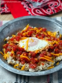 Huevos Rancheros Savory Oats are rolled oats topped with poached farm fresh eggs, nestled into flavorful tomato salsa.