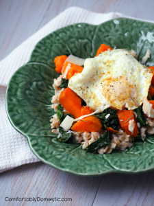 Savory spinach, roasted sweet potatoes, and a farm fresh egg resting atop a bed of oats are a healthy and satisfying way to start the day.