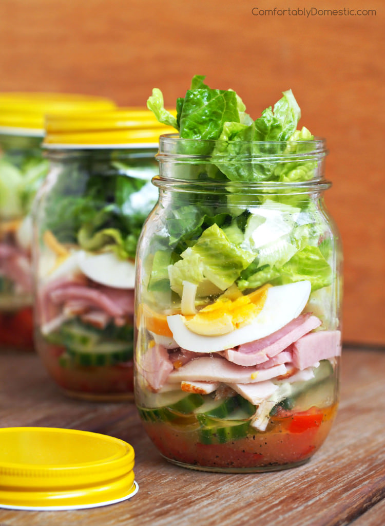 Chef Salad in a Jar - Crisp romaine lettuce, fresh vegetables, ham, turkey, egg, cheese, & a tastyPparmesan vinaigrette dressing.