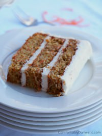 Delicately spiced carrot cake, loaded with finely shredded carrots and a tender crumb, enrobed in a fluffy crystallized ginger cream cheese frosting. | ComfortablyDomestic.com