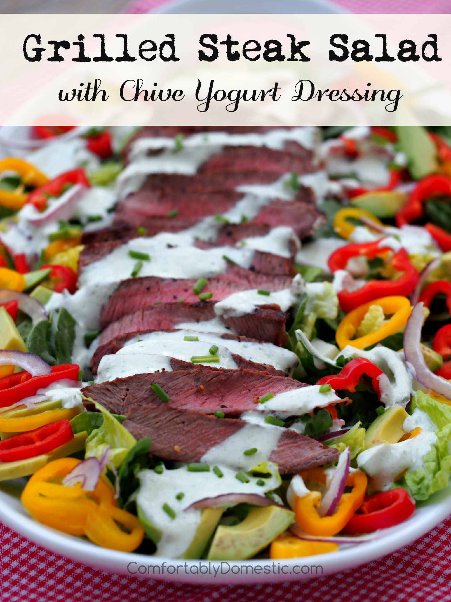 Grilled Steak Salad - Grilled steak sliced over colorful greens, sweet bell peppers, avocado, and thinly shaved red onion Drizzled with healthy, flavorful chive yogurt dressing. | ComfortablyDomestic.com