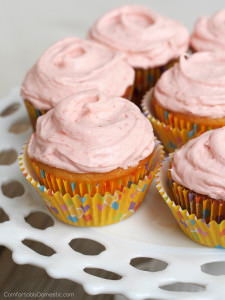 Strawberry Lemonade Cupcakes from scratch - Bright and tangy lemon cupcakes made from scratch and topped with a glorious fresh strawberry buttercream frosting is a delightfully crave-able combination. | ComfortablyDomestic.com