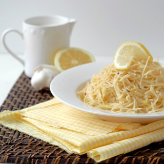 Easy lemon cream pasta is delicate angel hair pasta, bathed in lemony cream sauce. It's simple enough for busy weeknights, but luxurious enough for easy entertaining. | ComfortablyDomestic.com