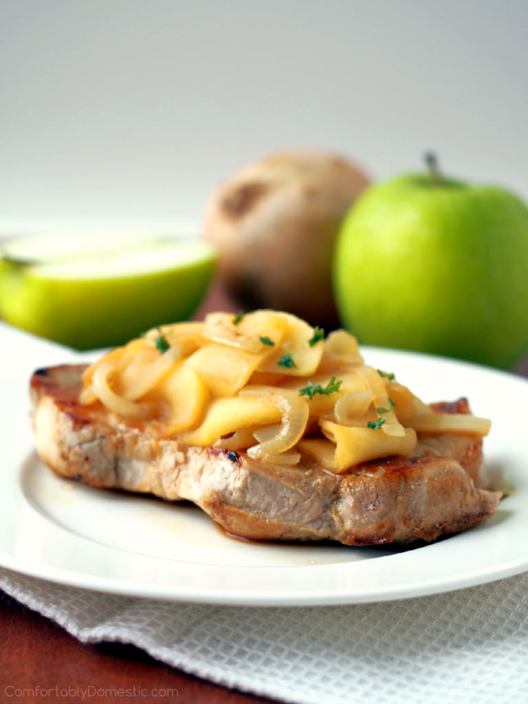 Apple Cider Pork Chops with Apples and Onions - Boneless pork loin chops seared to seal in the juices, and then simmered with delicately spiced apple cider, fresh apples, and onion for a sweet and savory meal in 30 minutes. | ComfortablyDomestic.com