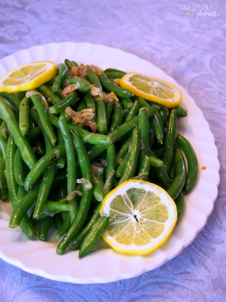 Garlic green beans are a delicious, easy to make holiday side dish! Fresh green beans are lightly steamed and tossed with a bright, lemon garlic butter sauce with caramelized shallots. | Get the recipe from ComfortablyDomestic.com