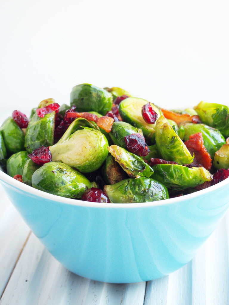 Pan seared Brussels sprouts are a healthy side dish, ready in minutes! Bright, earthy Brussels sprouts are caramelized with a touch of bacon and topped with tangy dried cranberries. | ComfortablyDomestic.com