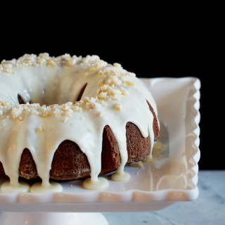 Gingerbread Cake with Orange Cream Glaze - Richly spiced Gingerbread Cake tickles the tongue with added depth of molasses, brightened with citrus notes of orange. | ComfortablyDomestic.com