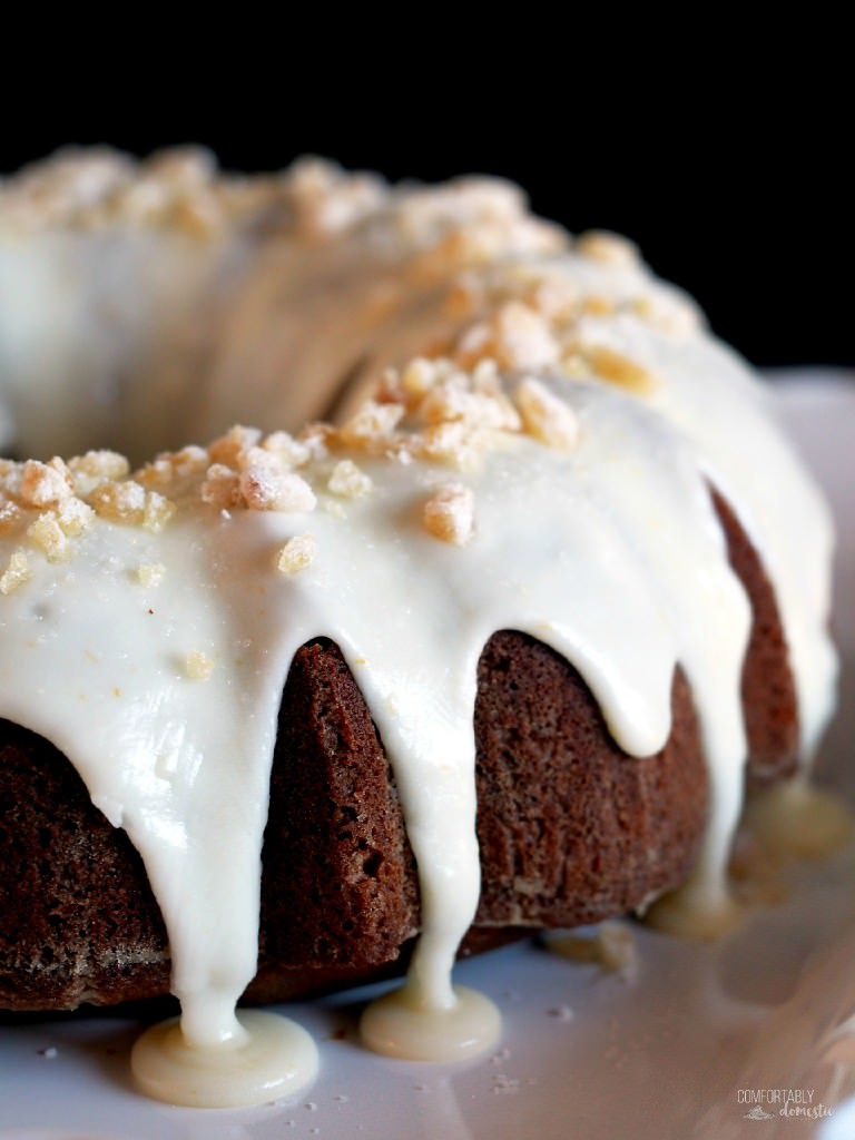 Gingerbread cake is richly spiced, tickling the tongue with added depth of molasses, brightened with citrus notes of orange cream glaze on top. | ComfortablyDomestic.com