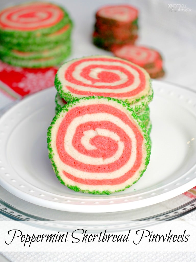 Peppermint shortbread pinwheel cookies are the perfect cookie recipe to make for your holiday cookie platter! Buttery vanilla and peppermint shortbread, presented in a fun pinwheel design. Edged in colored sugar, for an added touch of holiday sparkle. | ComfortablyDomestic.com