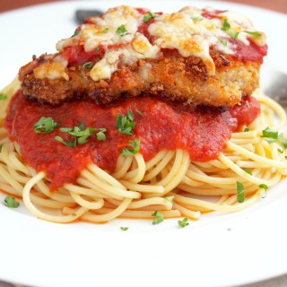 Baked-Chicken-Parmesan - Baked Chicken Parmesan takes a lighter spin, using economical chicken thighs coated in seasoned bread crumbs, drizzled with butter, and then baked until crisp. The crunchy, juicy chicken is finished with a touch marinara and parmesan cheese for that classic, comforting flavor with fewer calories. | ComfortablyDomestic.com