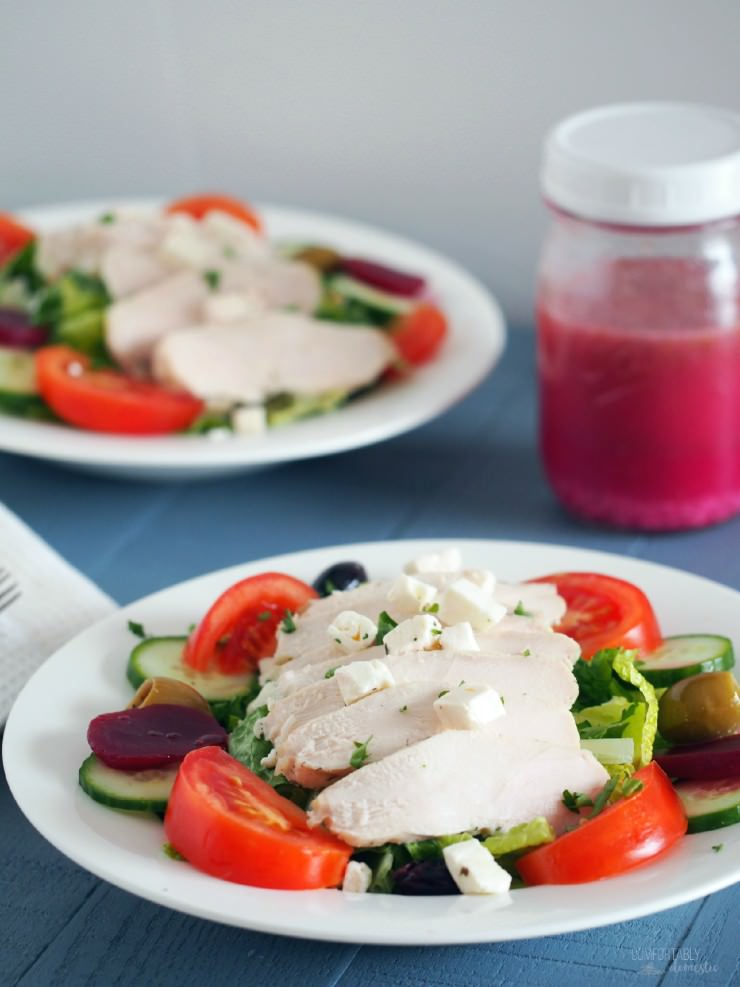 Chicken-Greek-Salad rests tender chicken atop such traditional ingredients as crisp greens, pickled beets, tomato, cucumber, olives, red onion, plenty of feta cheese, and a healthy drizzle of restaurant style Greek dressing.