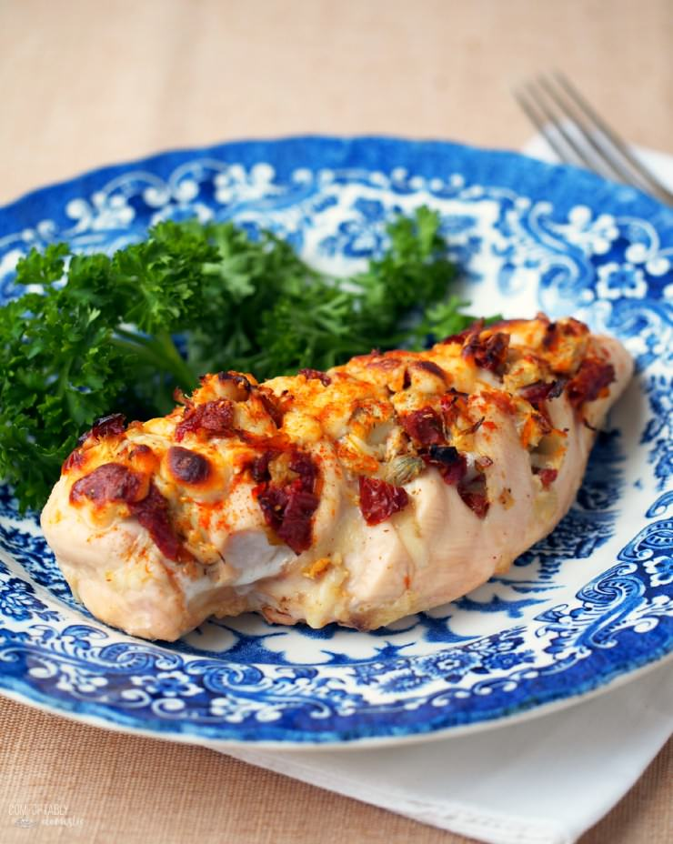 Hasselback-Stuffed-Chicken is stuffed with artichoke hearts, sun-dried tomatoes, plenty of cheese, and then roasted until tender and bursting with flavor.
