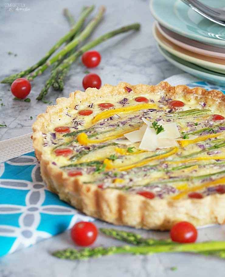 Spring-Vegetable-Tart-is-a-balanced-vegetarian-quiche with loads of fresh spring asparagus, sweet bell peppers, tangy purple onion, fluffy eggs, and creamy cheese nestled in a buttery crust.