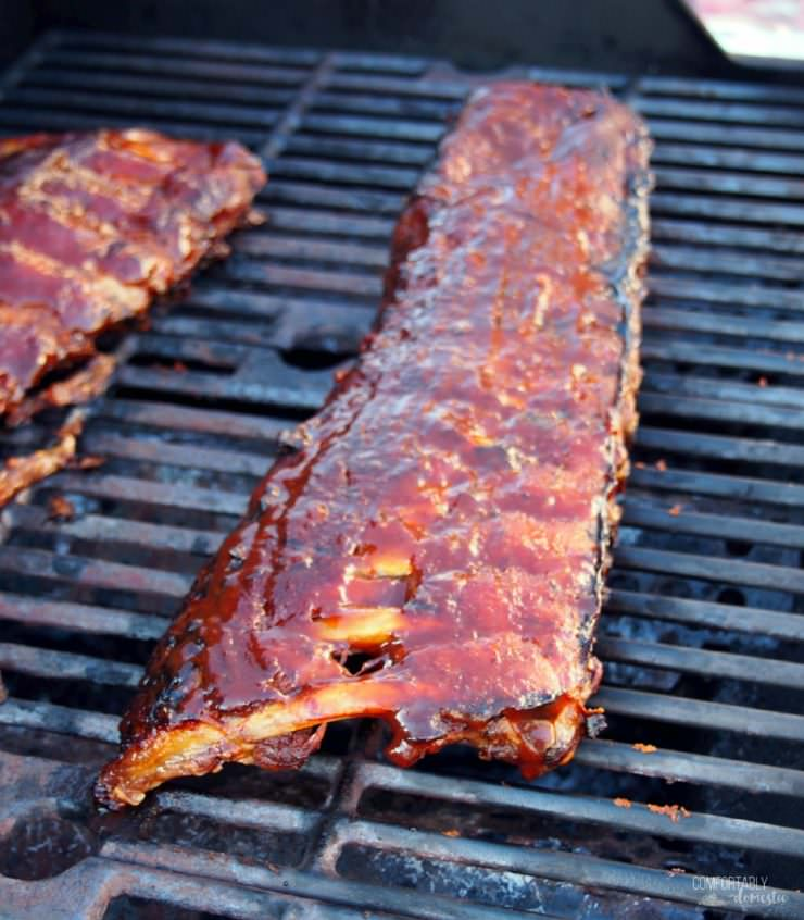 Perfect Barbecued Ribs are slow roasted and finished on the grill with a sticky-sweet sauce, for ribs that are fall-off-the-bone tender.